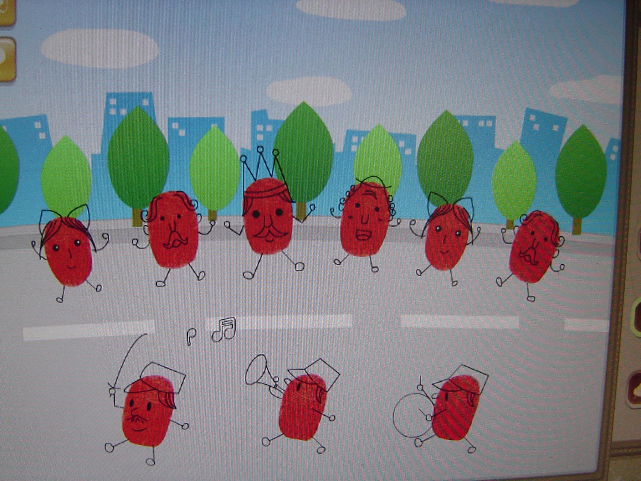 今天我们学了画画《小人国》,就是用手指蘸上颜料点画指纹,然后在指纹