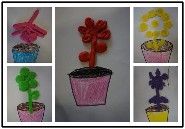 春天来了,孩子们用橡皮泥做了一朵朵美丽的小花