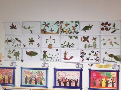 泖港幼儿园中班组开展亲子制作树叶贴画活动